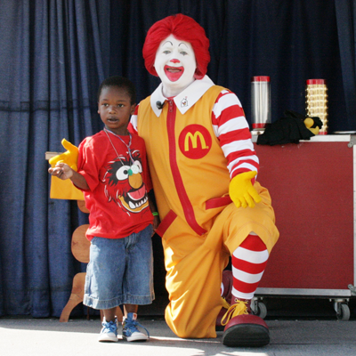 Ronald McDonald with a kid