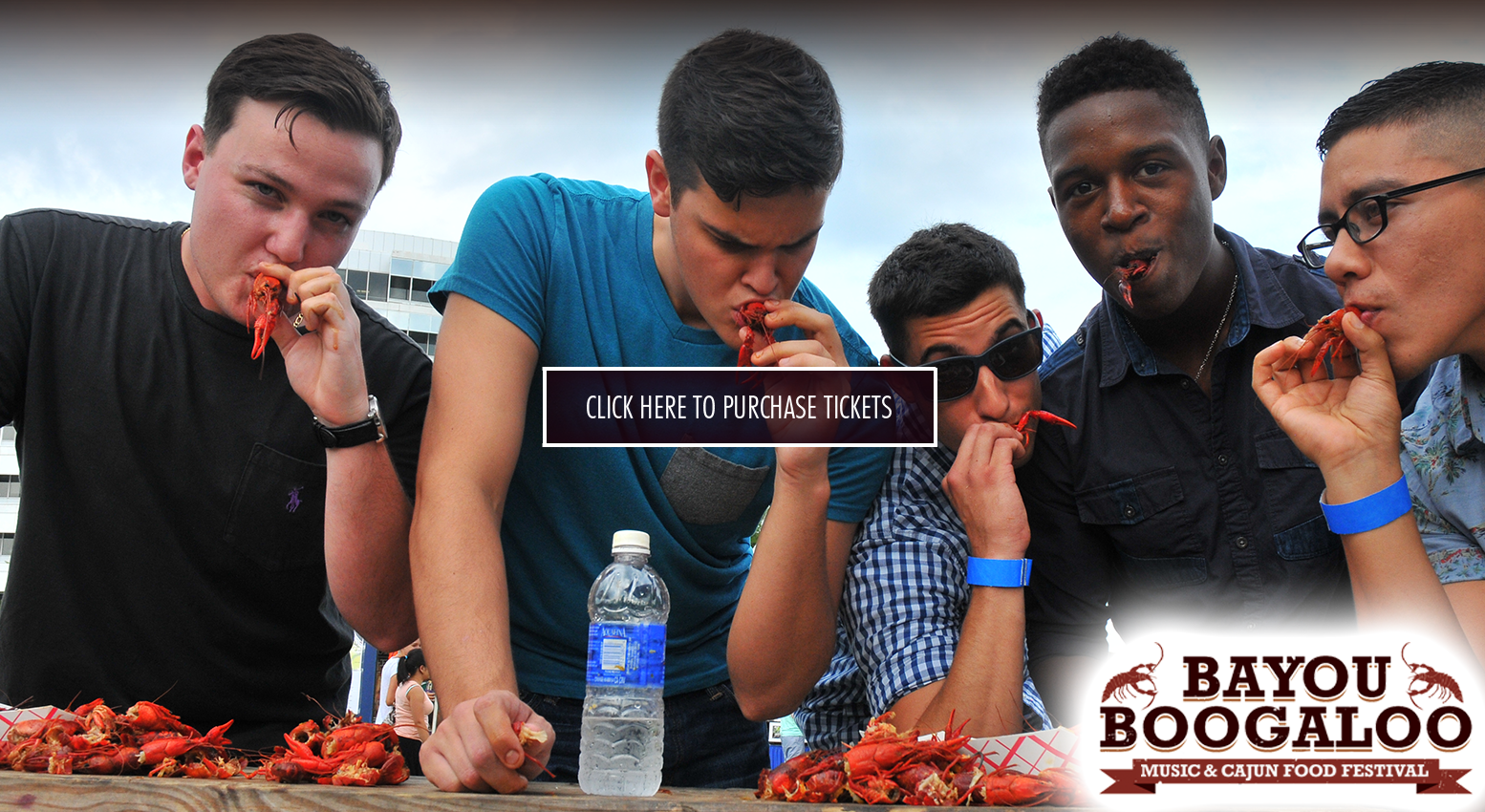 young men eating cajun shrimps